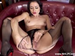 Horny brunette rips pantyhose masturbates in high heels