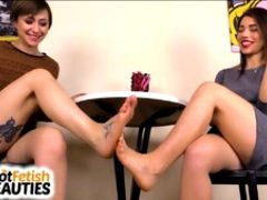 Sexy lesbian footsie under the table