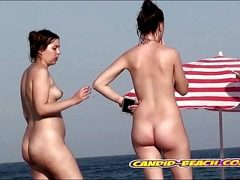 Tight pusssy nudist babes spied by voyeur cam at the beach