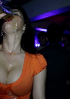 Really thirsty girl drinks full glass of beer in slo-mo